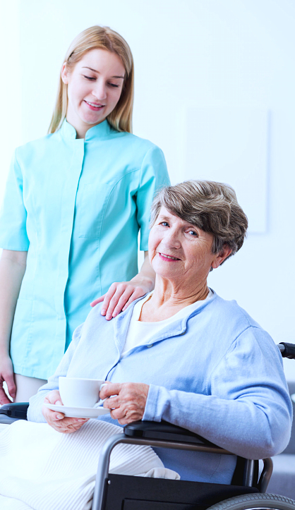 caregiver and senior woman on a wheelchair