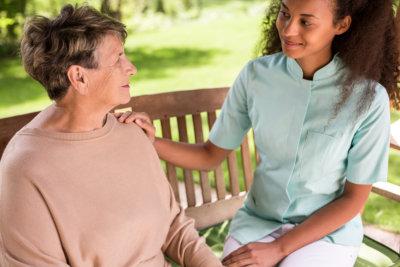 caregiver smiling at the elder