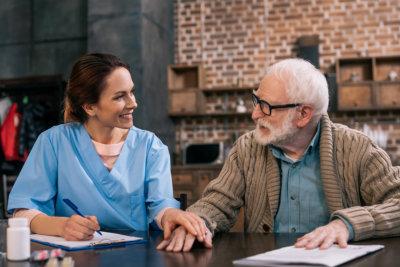 a caregiver with a senior man