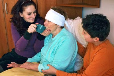 woman caring a senior woman